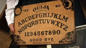 How do you use an Ouija board?