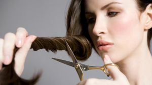 How do women cut their own hair?