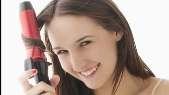 What Year Was the Curling Iron Invented?