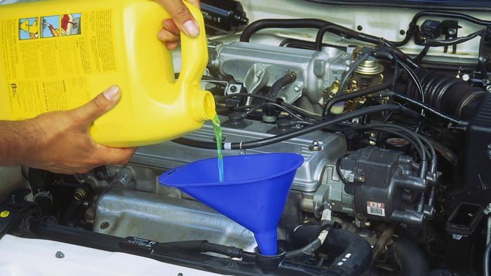 How do you add coolant to your car?