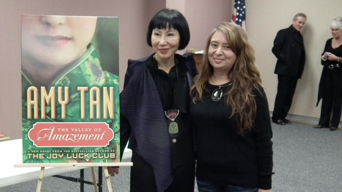How is Amy Tan's writing style characterized?