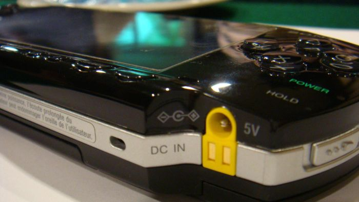 Where is the AOSS button on the PSP?