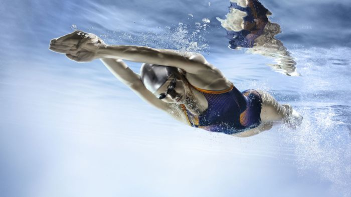 What is the average human swimming speed?