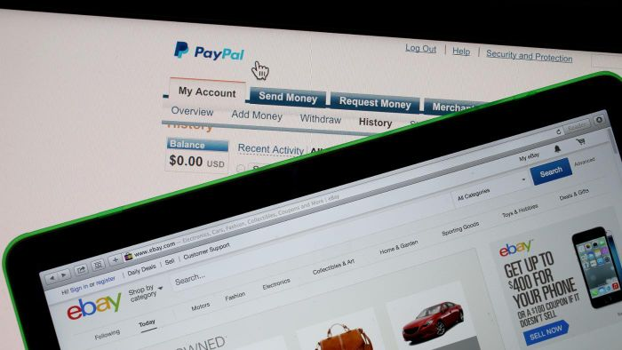 What are the benefits of paying for online purchases with PayPal over credit cards?