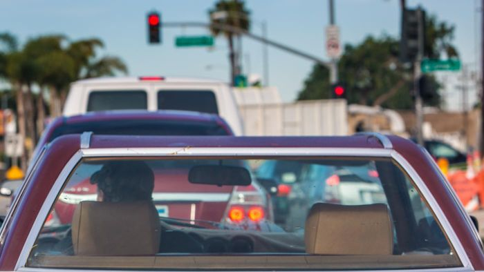 How do I contest a running a red light traffic violation in California?