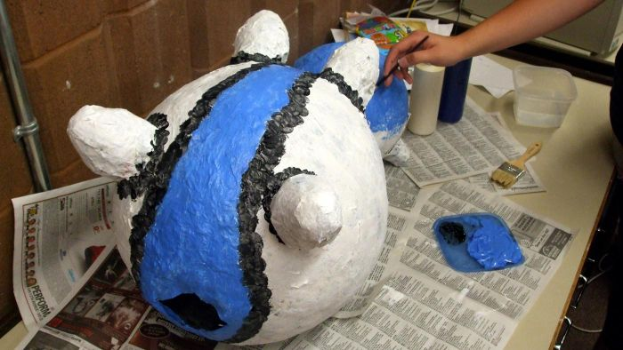 Can you dry paper mache in the oven?
