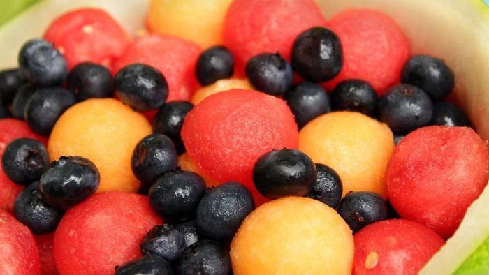 Where can fruits be looked up on a carb chart?