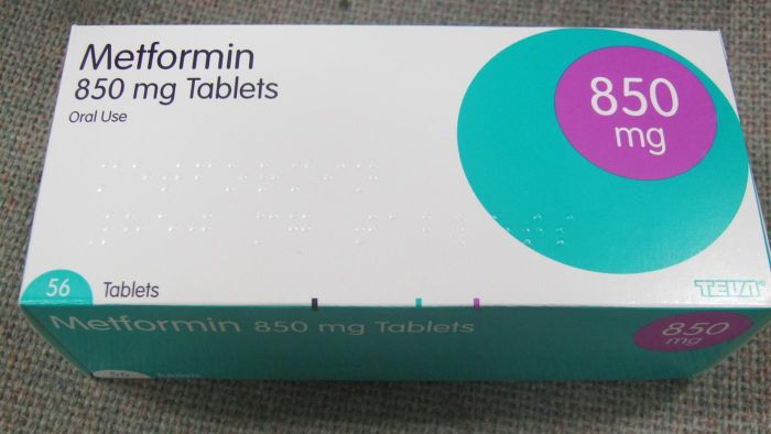 How can you minimize gas while taking Metformin?