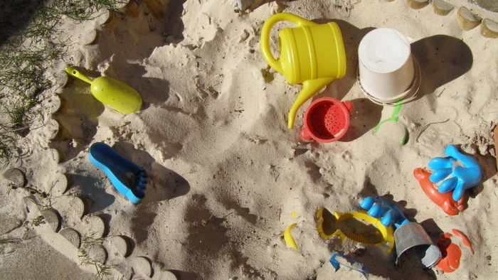 How Can a Person Determine the Amount of Sand Needed to Fill a Sandbox?