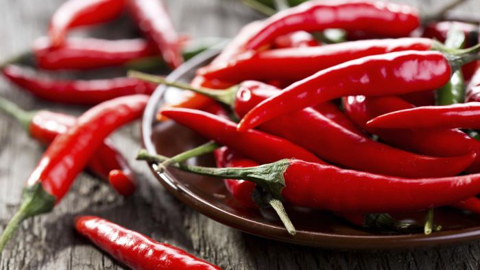 Where can you find photos of different hot peppers?