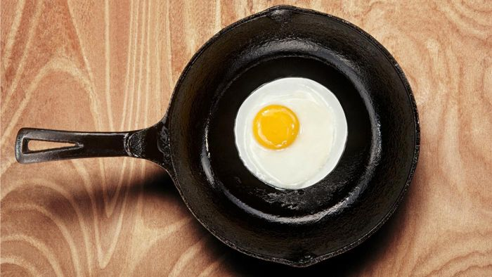 How do you clean a cast iron skillet?