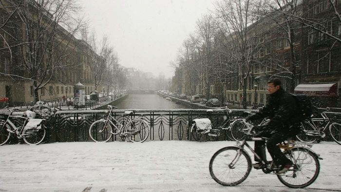 What currency is used in Amsterdam?