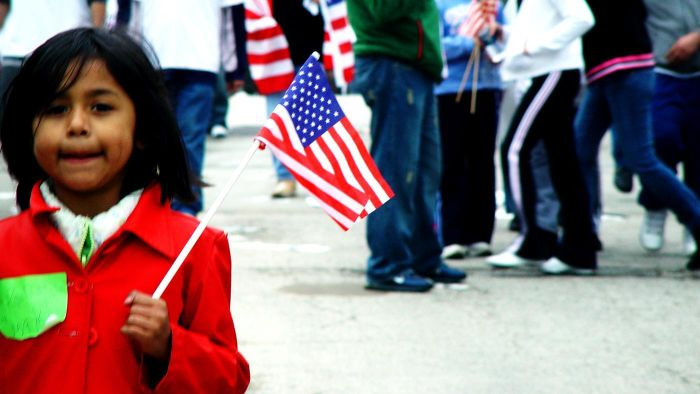 What is the difference between immigration and emigration?