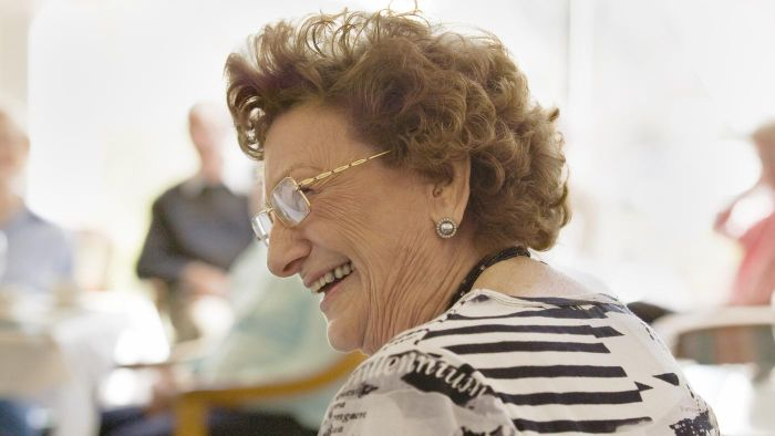 What are examples of programs offered at senior centers?