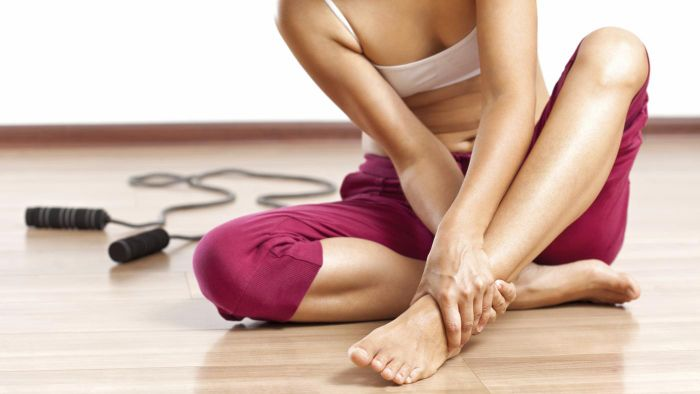 What is the best home treatment for a torn ligament in the ankle?