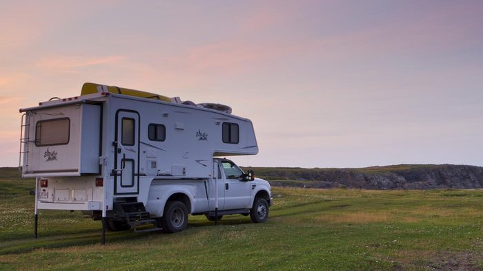 How do I install a camper shell on a truck?