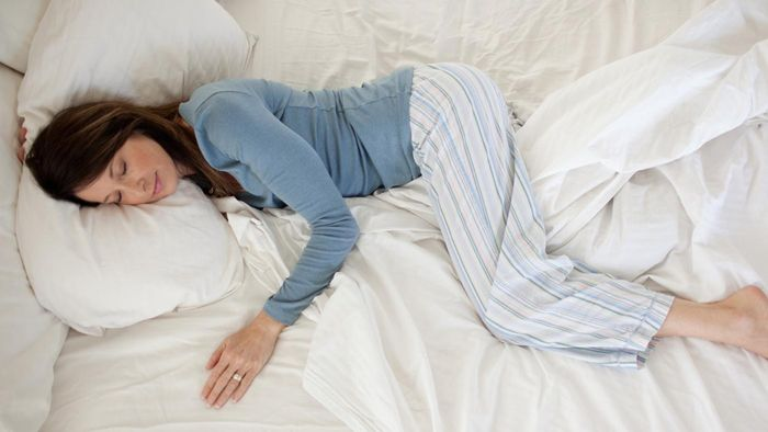 What percentage of an average human's life is spent sleeping?