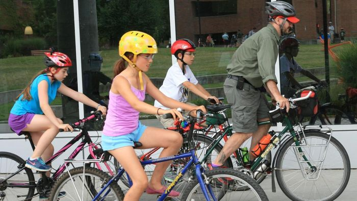 How is riding a bike an example of Newton's third law of motion?