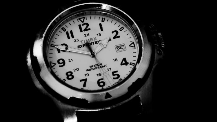 How do you set the date for a Timex Expedition Indiglo watch?