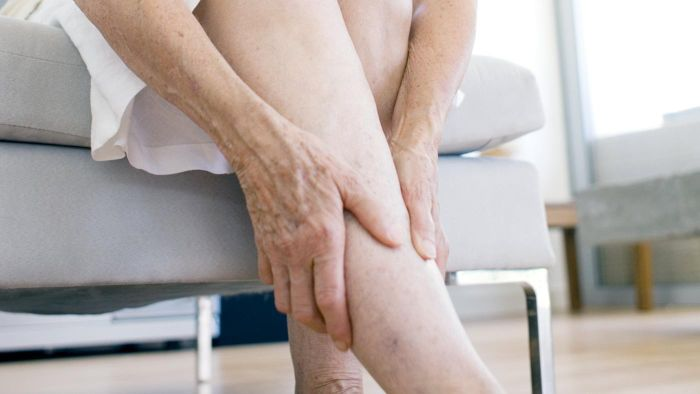 When should I seek medical help for a blood clot in the leg?