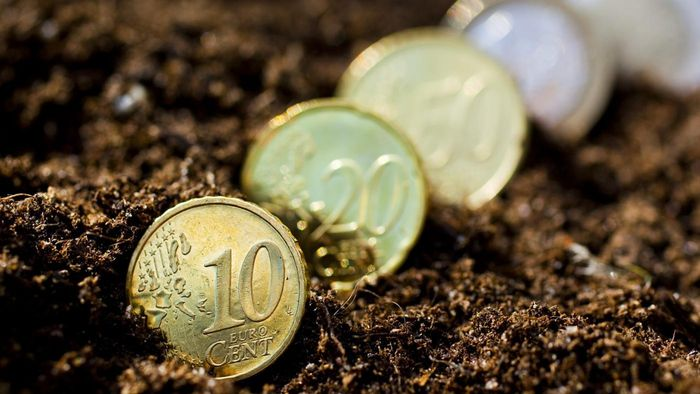 What Does Soil and a Coin Tied in a Piece of Textile Material Mean?