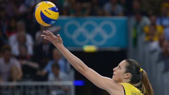 What are some tips for serving a volleyball overhand?