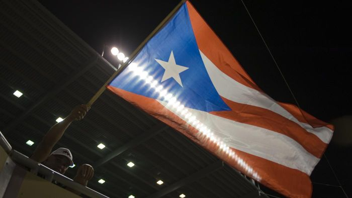 What type of government does Puerto Rico have?