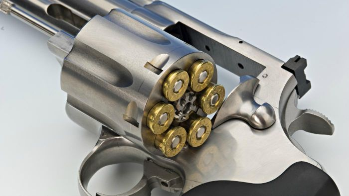 How do you unload a revolver?