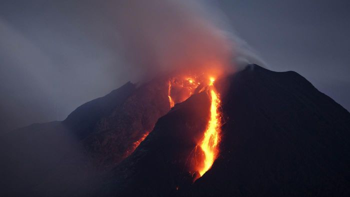 How do volcanoes affect the lithosphere?