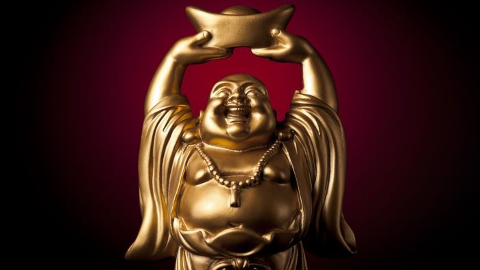 Why do people rub Buddha's belly for good luck?