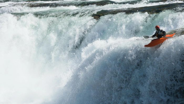 What is the world record for kayaking over a waterfall?