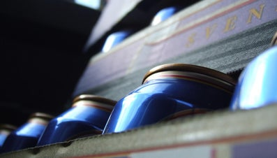 Why Are Beer Cans Curved at the Top and Bottom?