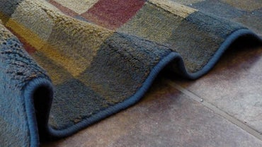 How Can a Wrinkled Rug Be Flattened?