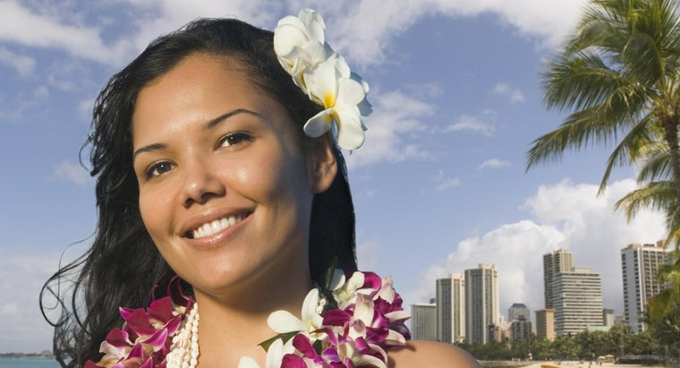 What Is the Meaning of the Hawaiian Tradition of Wearing a Flower Behind the Ear?