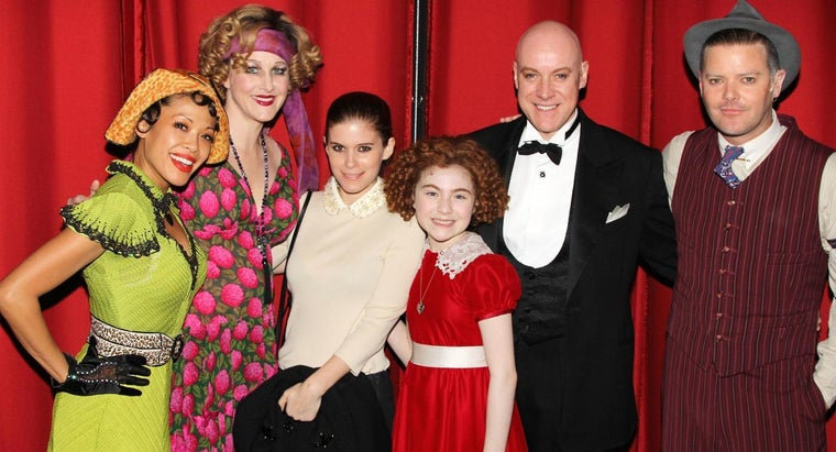 Who Was Orphan Annie's Wealthy Adoptive Father?