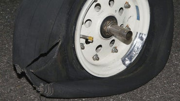 How Do You Remove the Spare Tire From a Chrysler Town and Country?