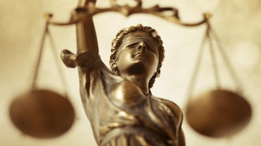 What Is the Difference Between Law and Justice?