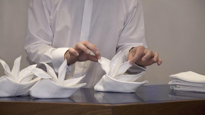 What Are Some Basic Techniques for Folding Napkins?