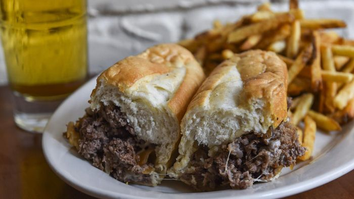 How do you make Philly steak sandwiches?