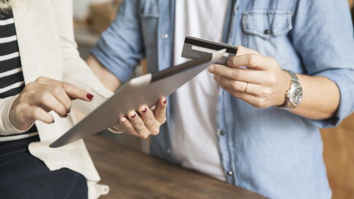 How do you conduct a credit card balance transfer?