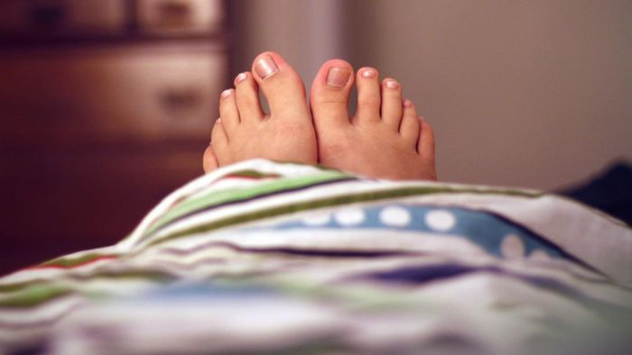 What are some recommended ways to treat toenail fungus at home?