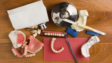 What Is the Difference Between Partial Dentures and Bridges?