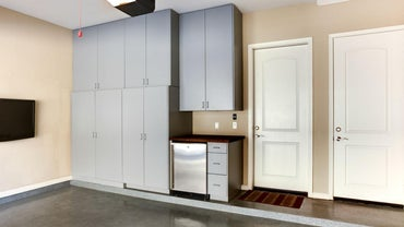 What Are Some Variations on Tall Wood Storage Cabinets?