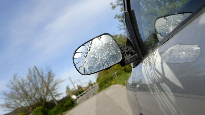 How do you repair the side-view mirror of a car?