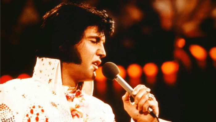What are some number one hits by Elvis?