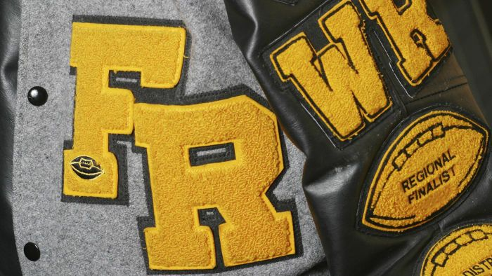 How do you earn a high school letterman jacket?