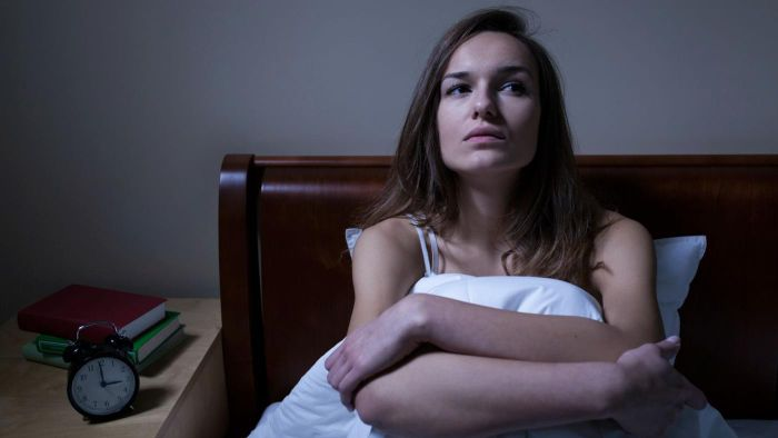 What are some causes of trembling during sleep?